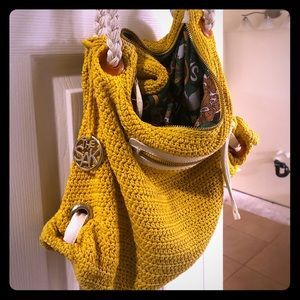 The Sak woven mustard color bag